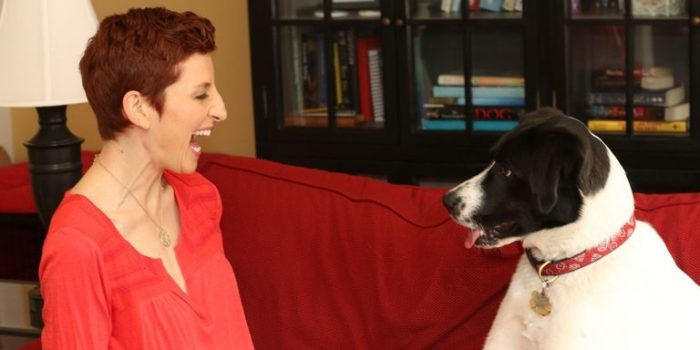 woman communicating with a dog telepathically