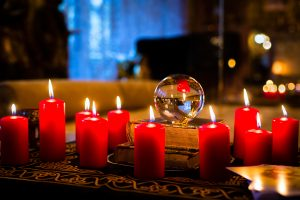 candles with a crystal ball